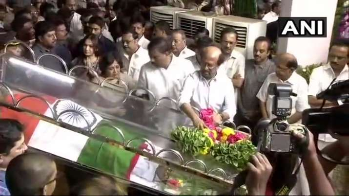 India Tv - Rajinikanth, Dhanush pay last respects to former Tamil Nadu CM M Karunanidhi at Chennai's Rajaji Hal