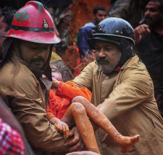 India Tv - Idukki: Fire Services personnel rescue a child following a landslide, triggered by heavy rains, in Idukki, Kerala on Thursday