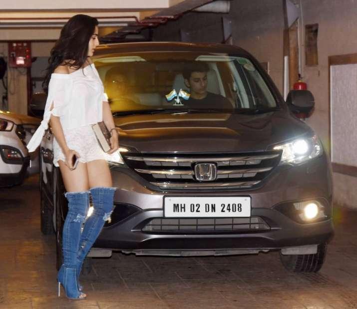 India Tv - Sara Ali Khan wearing denim boots