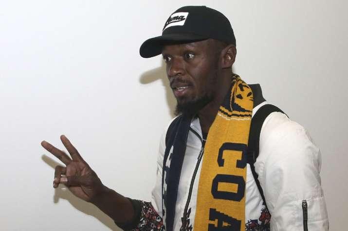 Usain Bolt arrives for trial in Australian soccer's A-League