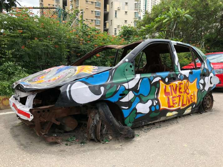 India Tv - Once abandoned junk, the car now stands tall as beautiful piece of street art.