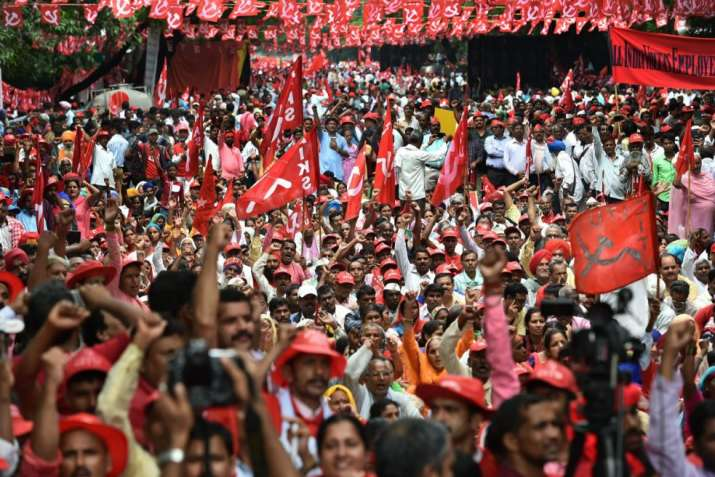 India Tv - New Delhi: Workers and farmers of various unions raise slogans during 'Mazdoor Kisan Sangharsh Rally' at Parliament Street