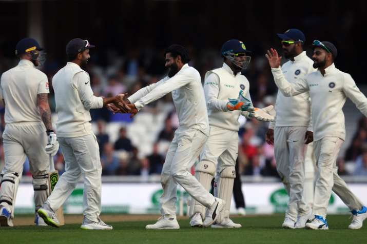 Ravindra Jadeja celebrates with teammates after trapping