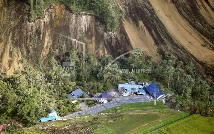 India Tv - This aerial photo shows houses destroyed by a landslide after an earthquake in Atsuma town, Hokkaido, northern Japan, Thursday, Sept. 6, 2018. (Kyodo News via AP)