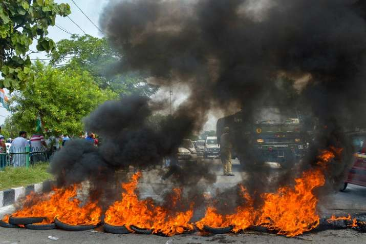India Tv - Congress Party workers burn tyres during 'Bharat Bandh' protest called by Congress and other parties against fuel price hike and depreciation of the rupee, in Jammu.