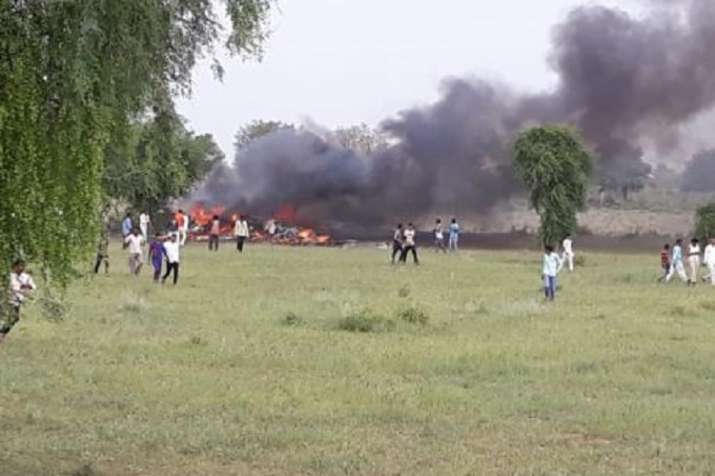 India Tv - The MiG 27 burst into flames after crash into an open field in Jodhpur. (Photo:IndiaTV)