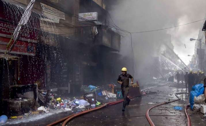 India Tv - Firefighters try to douse a fire that broke out in a multi-storied wholesale Bagree market, at Burrabazar in Kolkata, Sunday, Spet 26