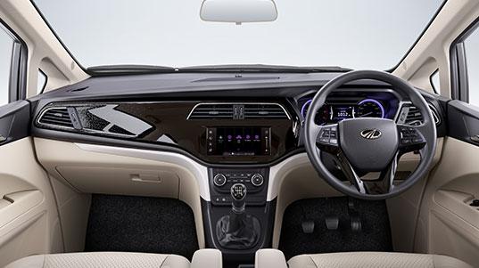 India Tv - Mahindra Marazzo offersa piano black and beige finishwith a multi-function steering wheel