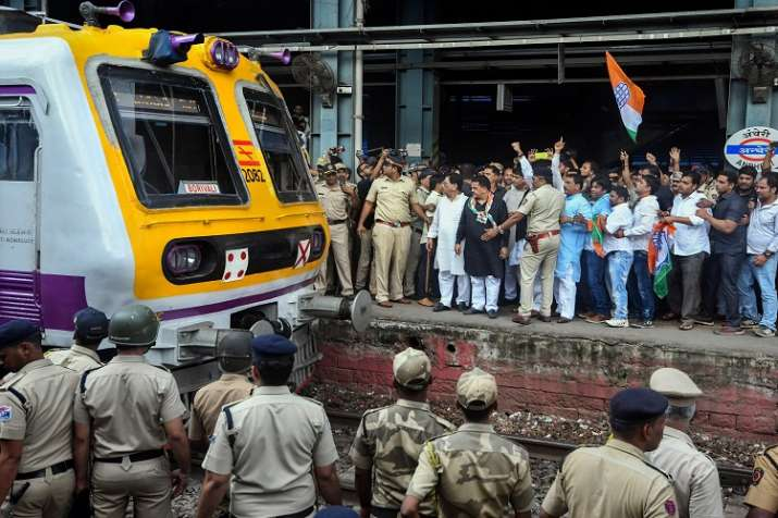 India Tv -   Congress workers stop a train at Andheri during 'Bharat Bandh' protest called by Congress and other Left Front parties against fuel price hike and depreciation of the rupee, in Chikmagalur on Monday.