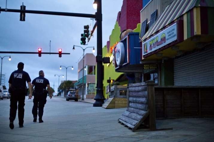 India Tv - Police patrol the boardwalk in Myrtle Beach, S.C., as Hurricane Florence approaches the east coast.