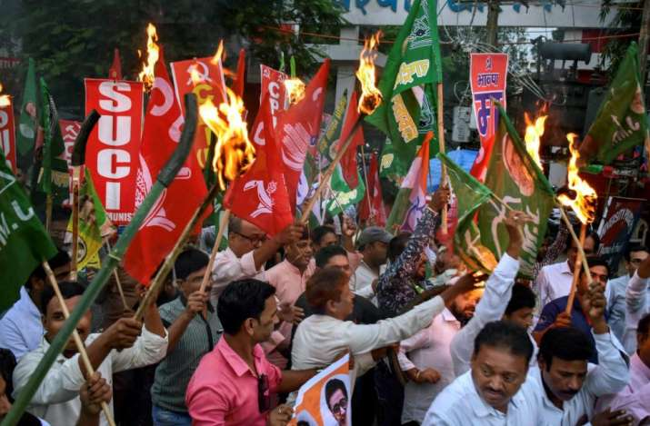 India Tv -  Leaders of several opposition parties hold a torchlight procession during a protest against the fuel price hike ahead of Bharat Bandh, in Ranchi, Sunday