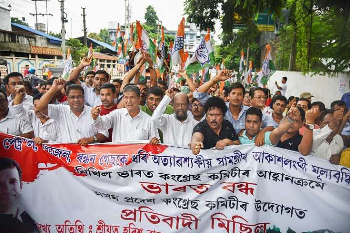 India Tv - Congress in-charge for Assam, Harish Rawat, and party supporters during 'Bharat Bandh' protest called by Congress and other parties against fuel price hike and depreciation of the rupee, in Guwahati.