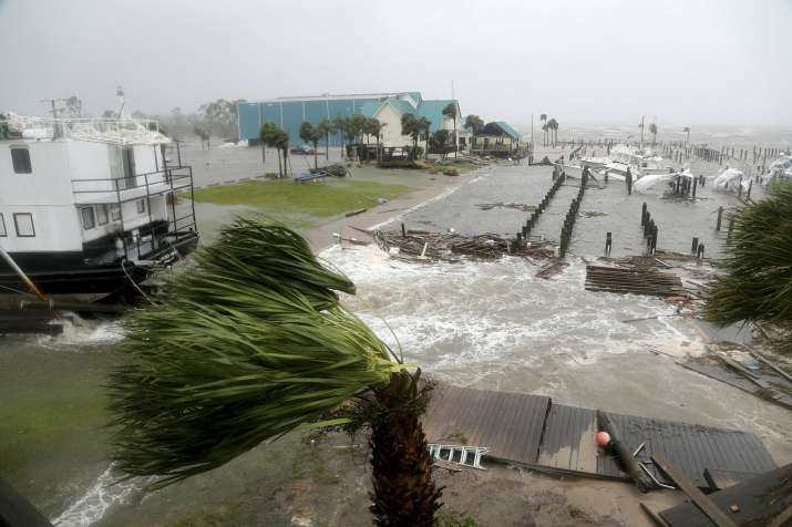 India Tv - Supercharged by abnormally warm waters of the Gulf of Mexico, the Category 4 storm crashed ashore in the early afternoon near Mexico Beach.