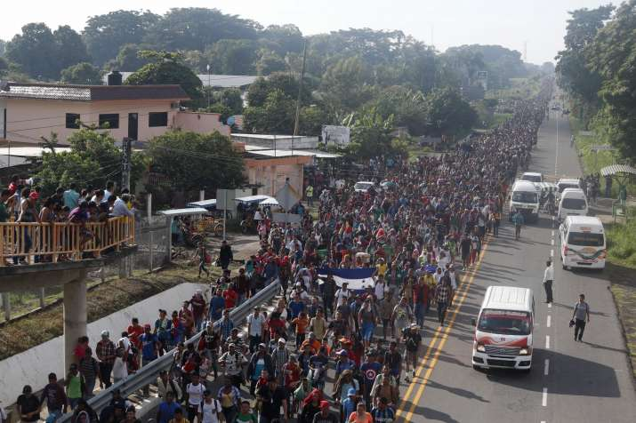 About a thousand migrants, including women and children,