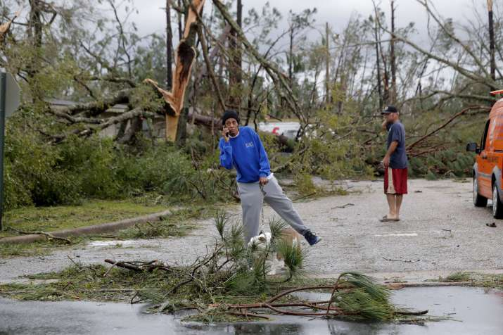 India Tv - In north Florida, Michael battered the shoreline with sideways rain, powerful gusts and crashing waves, swamping streets and docks, flattening trees, shredding awnings and peeling away shingles.