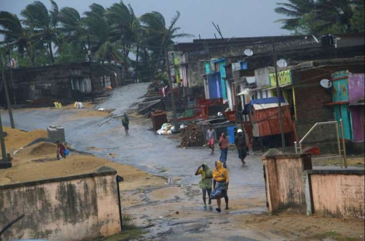 Ganjam: Locals walk near their houses as Cyclone 'Titli'