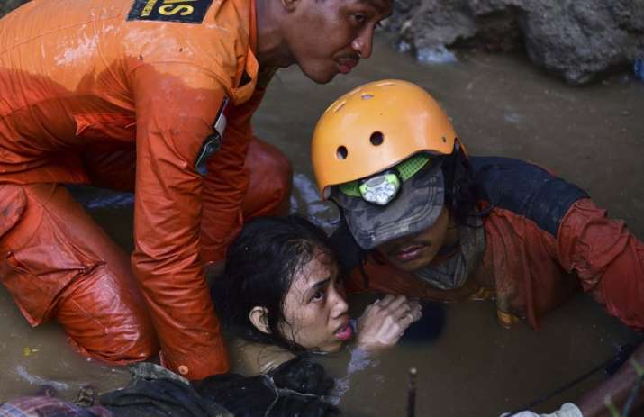 India Tv - The tsunami and quake liquedified land turning it into quicksand-like mud inSigi and Balaroa areas. Several buildings were engulfed along with people in the incident.
