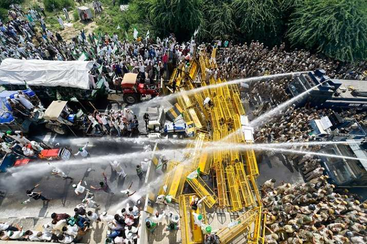 Police use water cannons to disperse farmers protesting at