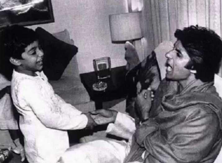 India Tv - Amitabh Bachchan making son Abhishek Bachchan laugh!