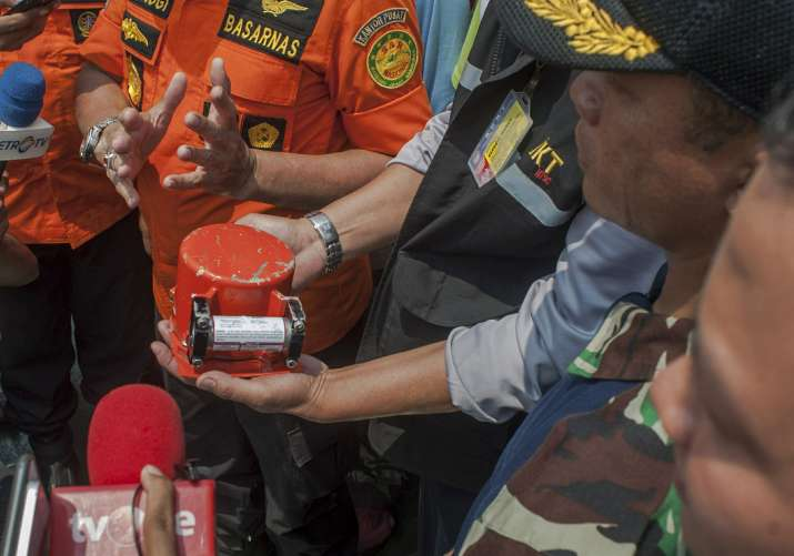 India Tv - Minutes after the device was taken out of the sea, Bambang Irawan, an investigator with the transport safety committee, said it was the flight data recorder.