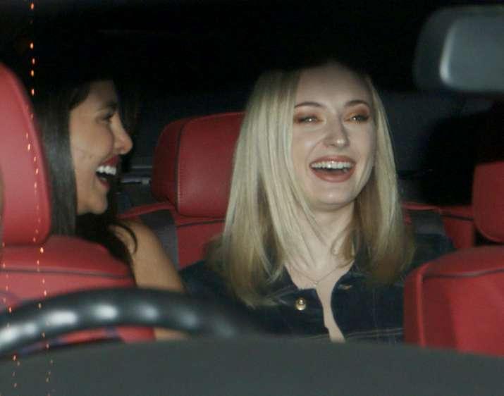 India Tv - The J sisters, Priyanka Chopra and Sophie Turner, sharing a good laugh in the car