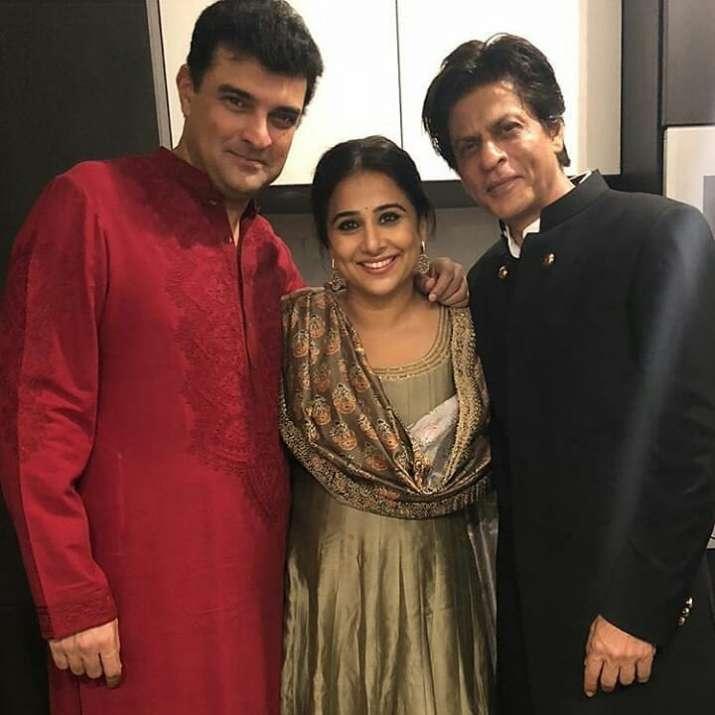 India Tv - Shah Rukh Khan poses with Vidya Balan and husband Sidharth Roy Kapur