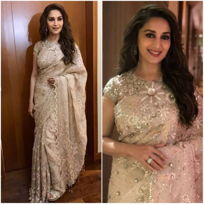 India Tv - Madhuri Dixit looks heavenly in white