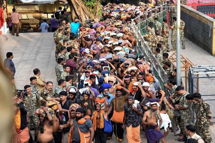 Devotees arrive at Sabarimala Temple, in Pathanamthitta