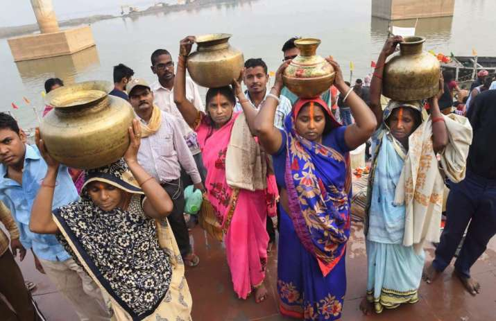India Tv - Devotees carry holy Ganga water for preparations of 'prasad' during the Chhath Puja festival, in Patna, Sunday