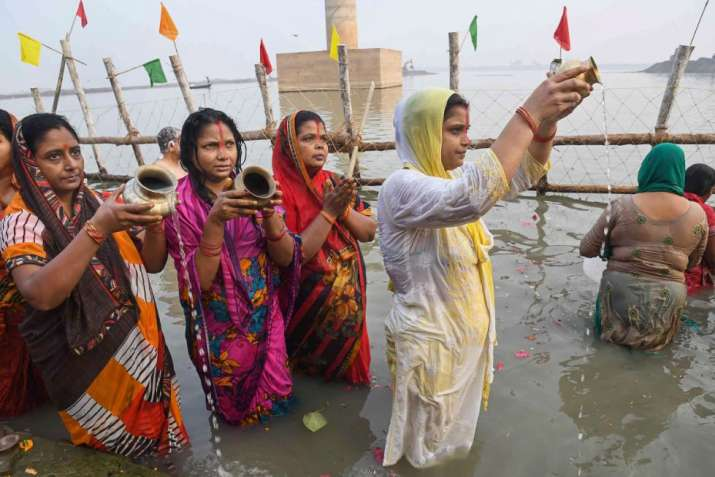 India Tv - Devotees offer prayers after taking a holy dip in the Ganga river during 'Nahay Khay' Puja of the Chhath Puja festival, in Patna, Sunday
