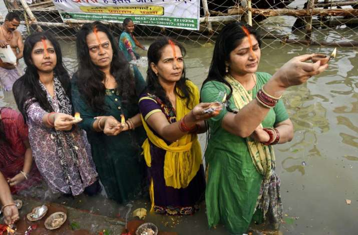 India Tv - Women offer prayers to the Sun god after taking holy dip in Ganga river during 'Kharna Puja' of Chhath festival in Patna, Monday