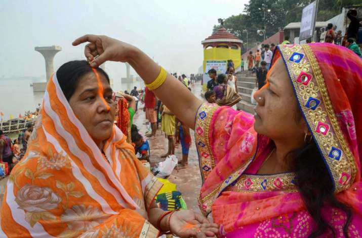India Tv - Women apply long 'Sindoor' as part of rituals after taking holy dip in Ganga river during 'Kharna Puja' of Chhath festival in Patna