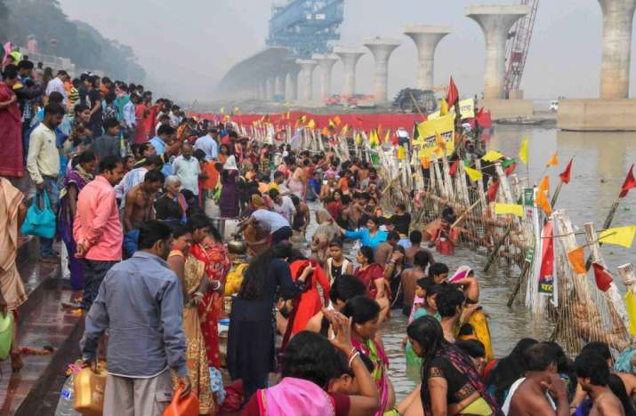 India Tv - Devotees take bath in Ganga river during 'Kharna Puja' of Chhath festival in Patna, Monday