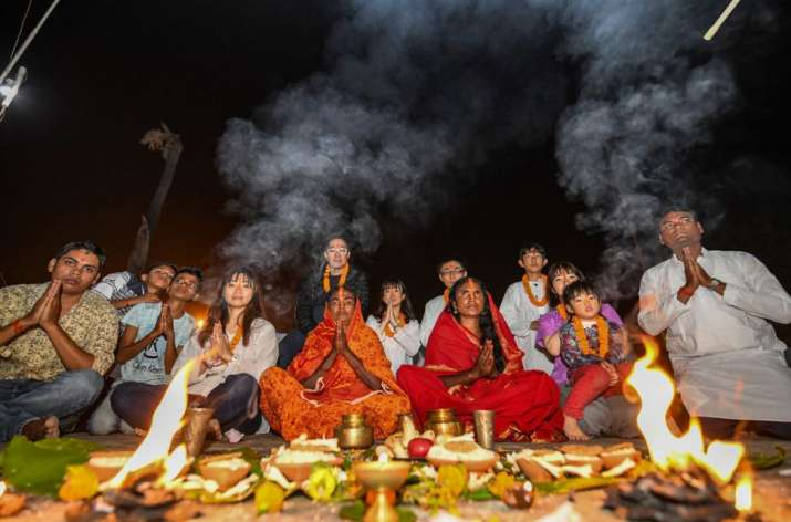 India Tv - Indian devotees along with Japanese nationals participate in 'Kharna' puja duirng the Chhath festival, in Bodh Gaya, Monday