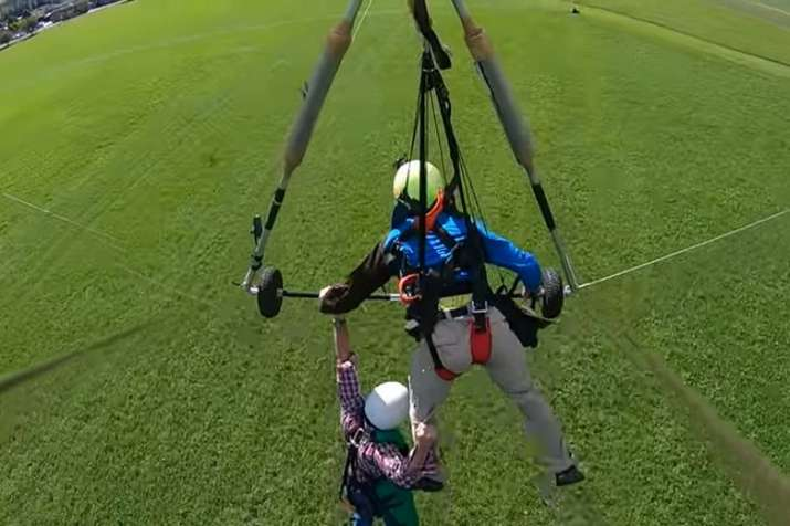 Swiss Mishap! Man hangs on to glider for life after
