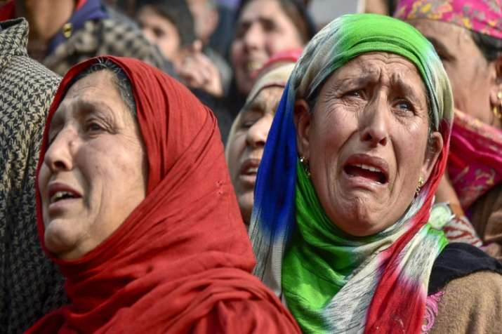 India Tv -  Family members and relatives mourn teh death of 16-year-old Numaan Ashraf who was killed in a clash near encounter site at Batagund area of Shopian districk of J&K on Sunday.