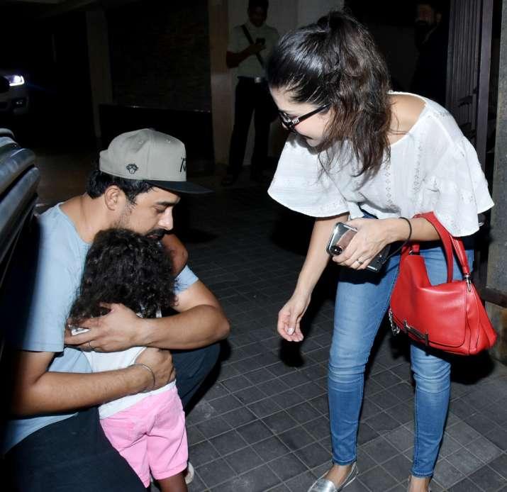 India Tv - Nisha hugging Rannvijay as mom Sunny watches