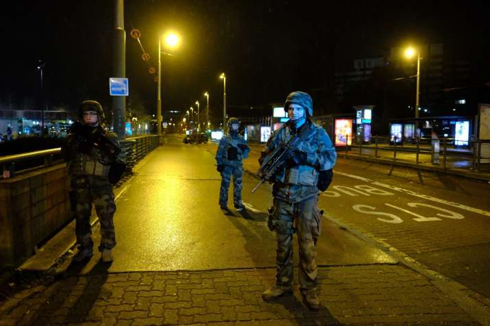 India Tv - French soldiers were on patrol after the shooting. At the scene, police officers, police vehicles and barricades surrounded the sparkling lights of the market.