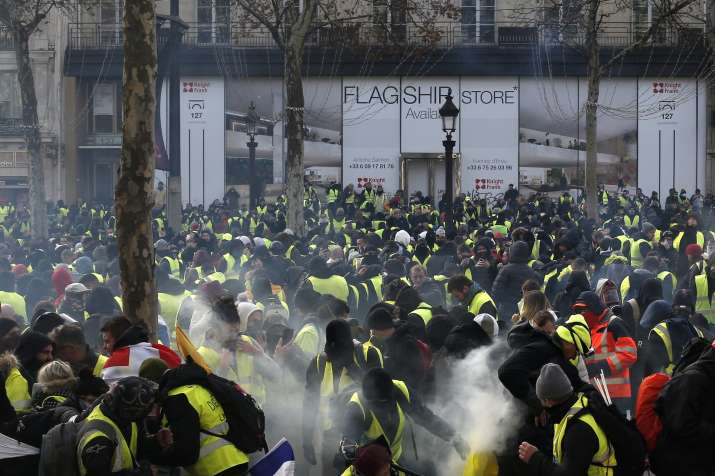 India Tv - France's yellow vest protesters have political stances ranging from the far right to the far left but the leaderless group is united in its sense that Macron and his government are out of touch.