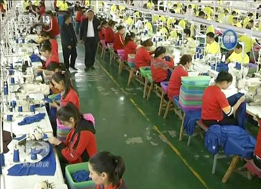 Trainees working at the garment factory