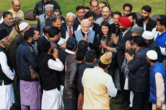 India Tv - File image of Prime Minister Narendra Modi interacting with the newly-elected Sarpanch of Panchayats from Jammu and Kashmir in New Delhi on Dec 19, 2018. (PTI)