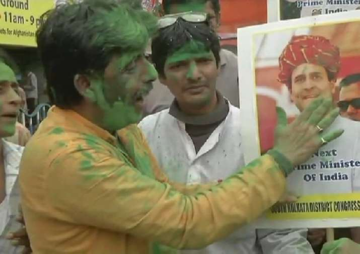 India Tv - Congress workers celebrate in Kolkata over party's good show in Assembly elections.