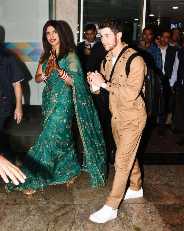 India Tv - Priyanka Chopra and Nick Jonas at Delhi airport
