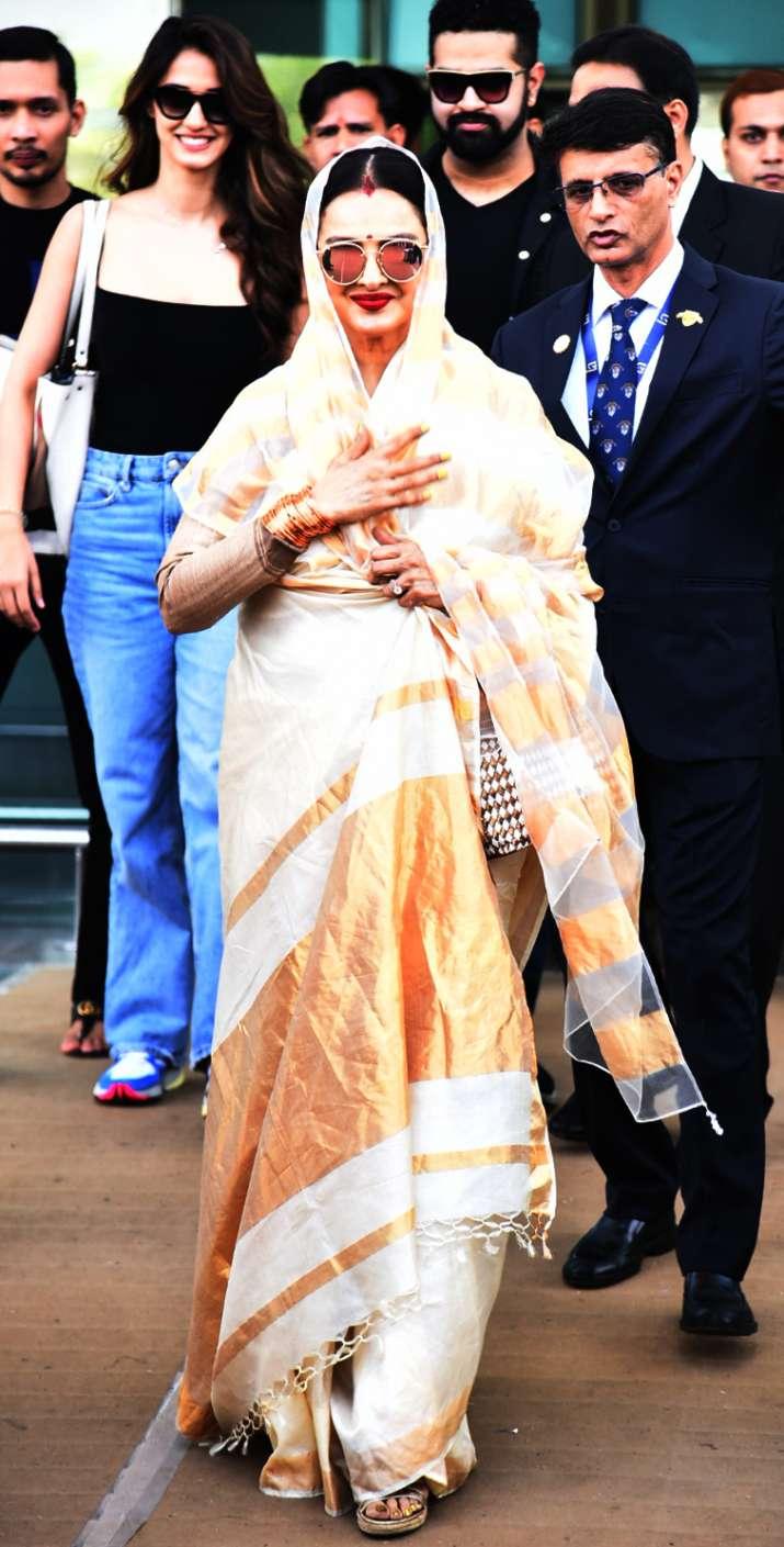 India Tv - Rekha spotted at airport for Isha Ambani-Anand Piramal Wedding