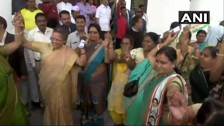 India Tv -  Congress workers celebrate inRaipuras party extends leads