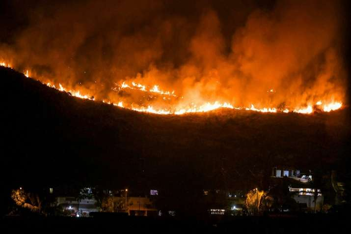 The blaze was noticed on one of the forested hills in