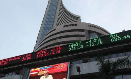 Sensex rallies over 300 points on positive global cues,