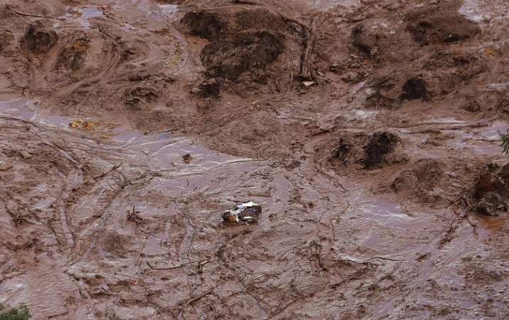 India Tv - A destroyed house in the midst of mud at the site of collapsed dam in Brazil
