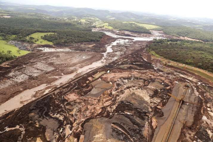 India Tv - An aerial view of the site at collapsed dam in Brazil