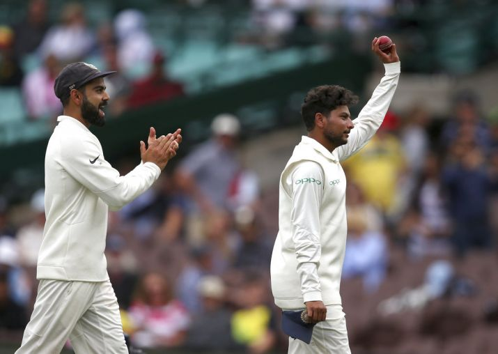 Kuldeep walks off after claiming his 2nd five-for in Tests.